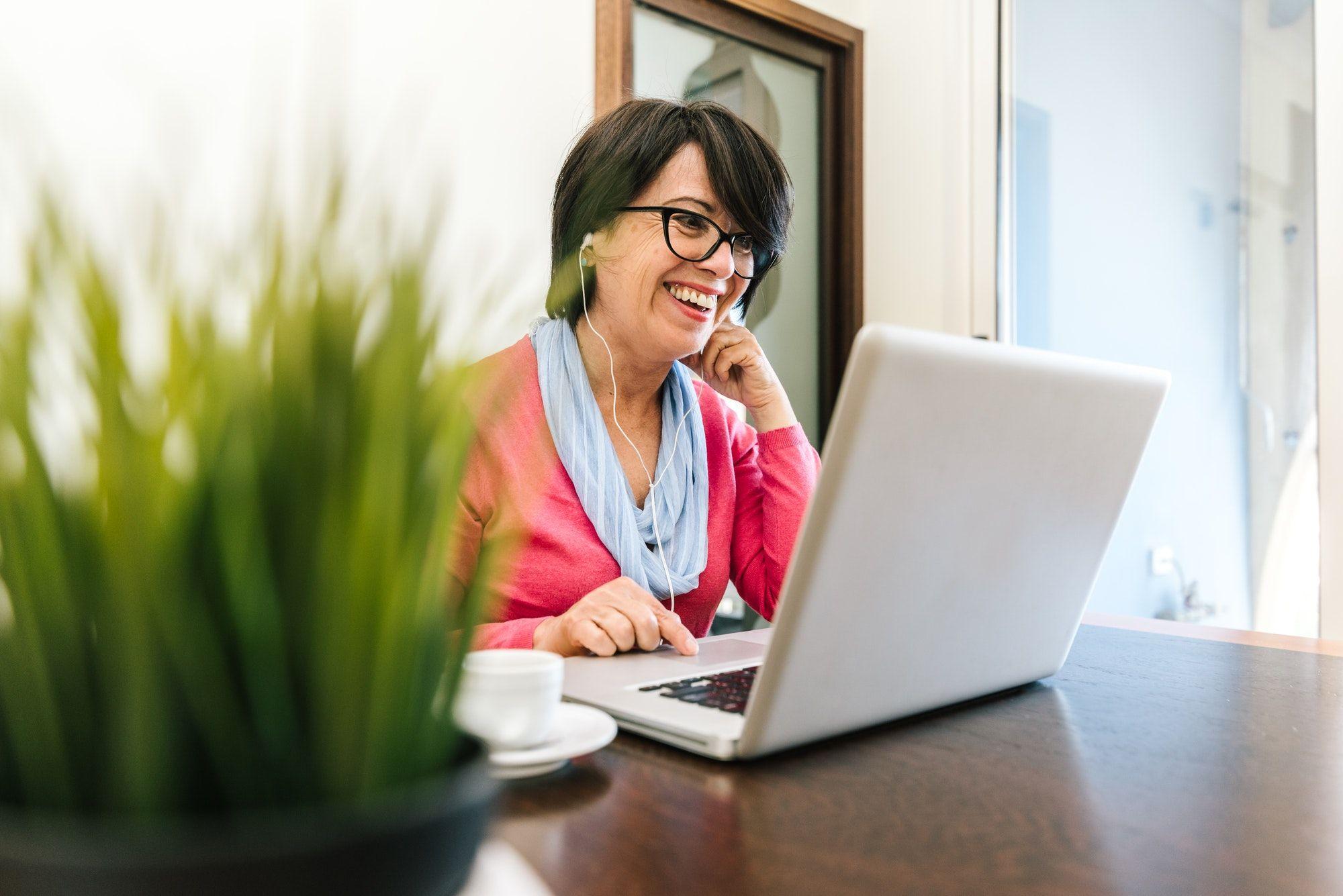 Mature woman using pc laptop indoor